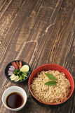 Noodles with sauce and ingredient on wood backgroound. Royalty Free Stock Photography