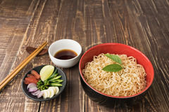 Noodles with sauce or shoyu and ingredient on table wood vintage backgroound in close up. Royalty Free Stock Photography