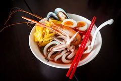 Noodles with seafood soup and red sauce. Noodles with seafood soup and red sauce, yong tau foo Stock Photo