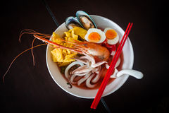 Noodles with seafood soup and red sauce. Royalty Free Stock Photo
