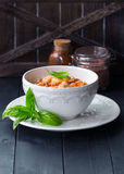Noodles with shrimp in the white bowl. Sweet and spicy shrimp with thin rice noodles. Chinese cuisine. Asian menu. Stir fry. Shrimps in sweet chili sauce with Royalty Free Stock Photography