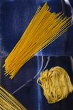 Noodles and pasta on an abstract blue background royalty free stock image