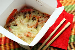 Noodles in take-out box. Noodles with cheese and vegetables in take-out box Stock Images