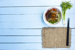 Noodles in Thailand Beef noodle on wooden sky blue table.top view. 1 Royalty Free Stock Photos