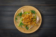 Noodles in Thick Gravy. Rad Na on the wooden table, Thai local food, Top view Royalty Free Stock Image