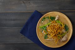 Noodles in Thick Gravy. Rad Na on the wooden table, Thai local food, Top view with copy space Royalty Free Stock Photos