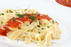 Noodles with tomato sauce and cheese. Decorated with parsley Royalty Free Stock Image