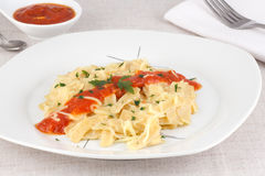 Noodles with tomato sauce and cheese. Decorated with parsley Stock Images