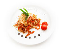 Noodles with tomato sauce and vegetables on white background Stock Photography
