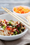 Noodles with tuna in a white bowl Royalty Free Stock Photos