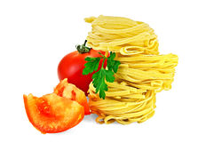 Noodles twisted with slices of tomato Stock Images