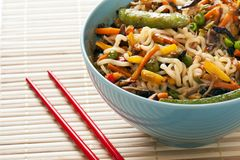 Noodles and Vegetables. Asian Noodles and Fried Vegetables in Bowl with Chopsticks Stock Image