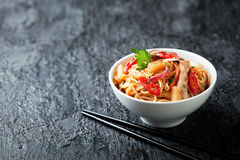 Noodles with vegetables, chicken and pineapple in sweet and sour sauce Stock Photos