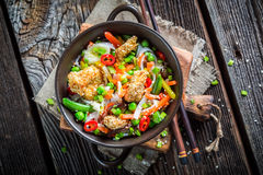 Noodles with vegetables and chicken with sesame Stock Image