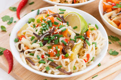 Noodles with vegetables, close-up, top view Stock Images