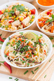 Noodles with vegetables and greens, fried rice with tofu Royalty Free Stock Image