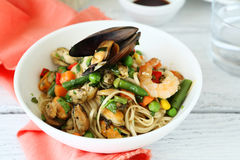 Noodles with vegetables and seafood in a bowl Stock Photography