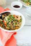 Noodles with vegetables and seafood Stock Image