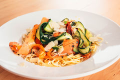Noodles vegetarian with carrots, zucchini, olive oil, parmesan, tomato Royalty Free Stock Image