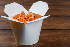 Noodles in a white box on wooden background Royalty Free Stock Photo