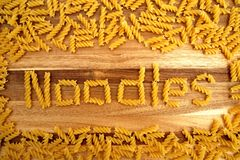 Noodles on wooden background royalty free stock photo