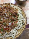 Noodles in Xinjiang are called `stripes`. stock photo