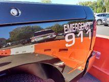 Noodsituatiewijzerplaat 911, Overdrukplaatje op een Politievoertuig, de V.S. Stock Foto's