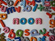 Noon banner with colorful letters stock image
