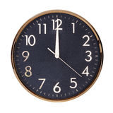 Noon on the dial of the round clock Stock Photography