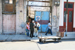 Noon in Havana. Cuba, Havana - 07 April, 2016: a group of Cubans, citizens of Havana, talk over serious matters of their lives in the backstreet during a siesta Royalty Free Stock Images
