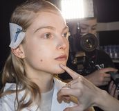 Noon by Noor FW 2018. New York, NY, USA - February 8, 2018: A model prepares backstage for Noon by Noor Fall/Winter 2018 runway show during New York Fashion Week stock images
