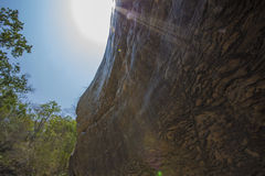 Noon time. Brown stone cliff below the sun on noon time royalty free stock photos