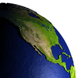 Noord-Amerika bij nacht op model van Aarde met in reliëf gemaakt land Stock Foto's