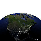 Noord-Amerika bij nacht op model van Aarde met in reliëf gemaakt land Stock Fotografie
