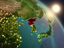 Noord-Korea van ruimte tijdens zonsopgang Stock Afbeelding