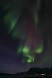Noordelijke Lichtengordijnen over Brenna Royalty-vrije Stock Afbeeldingen