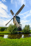 Noordeveldse Molen near the Dutch village of Dussen in full oper Stock Photography