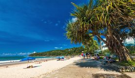 NOOSA, AUSTRALIA, FEB 17 2018: People enjoying Noosa main beach. NOOSA, AUSTRALIA, FEB 17 2018: People enjoying summer at Noosa main beach - a famous tourist stock image