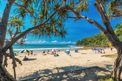 NOOSA, AUSTRALIA, FEB 17 2018: People enjoying summer at Noosa m. Ain beach - a famous tourist destination in Queensland, Australia royalty free stock photography