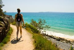 Noosa Head Trail. Woman walking on oceanside trail in Australia Royalty Free Stock Photos