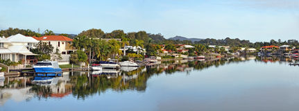 Noosa Waters Houses, Canal, Boats & Jetty, Queensland Australia. The canals panorama in beautiful Noosa Waters, Sunshine Coast, Queensland, Australia. Where you royalty free stock photo