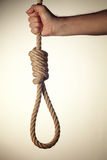 Noose. In hand on white background Royalty Free Stock Photo