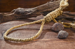 Noose knots with dead wood. And pebbles Royalty Free Stock Photos