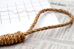 A noose on a news paper stock report Royalty Free Stock Photo