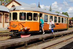 Embarking a railcar. Nora, Sweden - June 30, 2015: Passengers boarding an older class Y7 railcar at Nora station. Traffic is operatied by Nora Bergslags Veteran stock photos