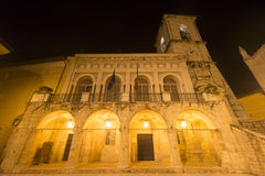 Norcia by night. Norcia (Perugia, Umbria, Italy): the main square, with the medieval Palazzo del Comune, by night Royalty Free Stock Photo