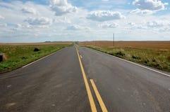 Nord Dakota, strada rurale Immagini Stock Libere da Diritti