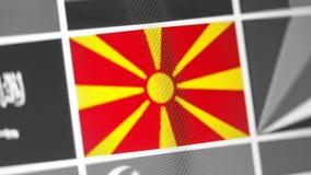Nord-Mazedonien-Staatsflagge des Landes Nord-Mazedonien-Flagge auf der Anzeige, ein digitaler Wässerungseffekt stockbild