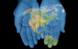 Nordamerika in unseren Händen Stockbild
