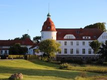 Nordborg Castle Denmark at Sunset with Blue Sky Royalty Free Stock Image